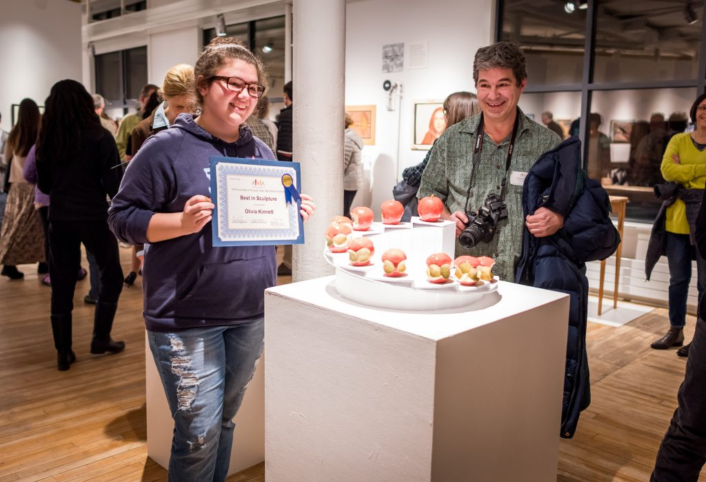 "Olivia Kinnett receiving the ""Best in Sculpture Award"" in AVA Gallery's 10th Annual Best of the Upper Valley High School Exhibition."